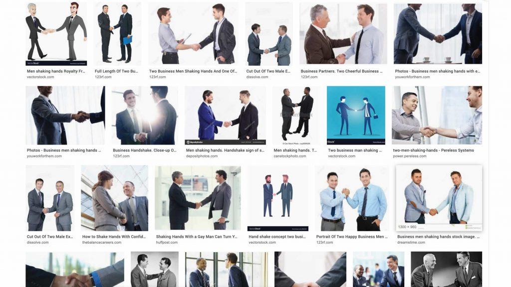 """Screenshot van zoekresultaat voor 'Men shaking hands"""". Resultaat: twee blanke mannen in pak schudden elkaar glimlachend de hand"""